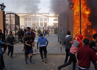 Fans had surged through the streets to attend a rally at their stadium, and a police club and the Egyptian football federation building were set alight in the chaos