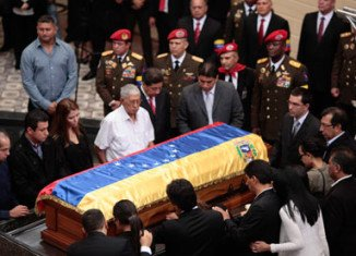 Hugo Chavez's body has been laid to rest at a military museum in Caracas