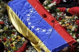 Hugo Chavez's coffin set off in a procession to the Military Academy, where he will lie in state till Friday