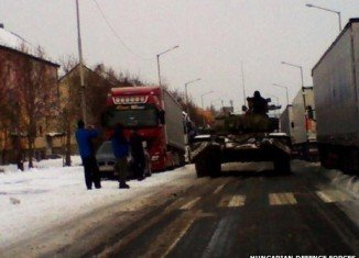 Hungary has deployed tanks to reach snowbound motorists as cold weather causes transport chaos across Eastern Europe