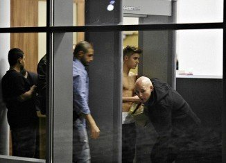 Justin Bieber was seen once again going shirtless as he stepped through a security gate at Wladyslaw Reymont Airport in Lodz, Poland