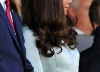 Kate Middleton, who is five months pregnant, appeared to hint she might be having a baby girl