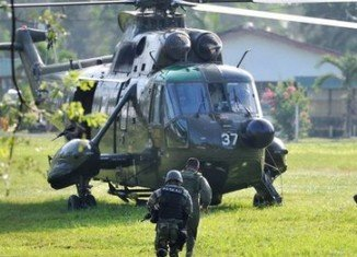 Malaysian troops have launched an assault on armed members of a Filipino clan in an ongoing conflict that has left at least 27 dead on Borneo island