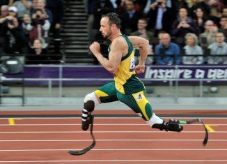 "Oscar Pistorius, who is accused of killing his girlfriend Reeva Steenkamp, may be ""on the verge of suicide"", according to a close family friend"