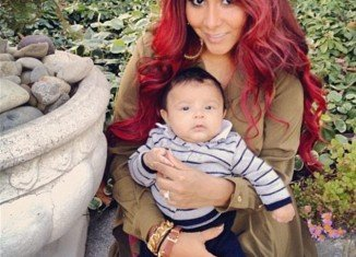 Snooki gave birth to her first child, Lorenzo, and is now offering advice for mom-to-be Kim Kardashian