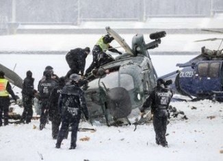 Two helicopters have crashed near Berlin's Olympic Stadium, leaving at least two people dead and several others injured