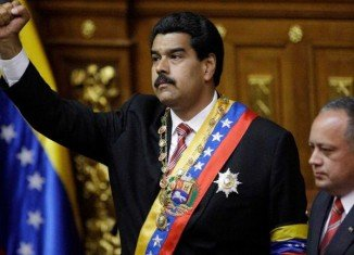Vice-president Nicolas Maduro has been sworn in as acting president of Venezuela hours after the state funeral of Hugo Chavez