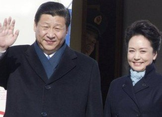Xi Jinping is accompanied by his wife, military singer Peng Liyuan, in his first overseas tour as China's president