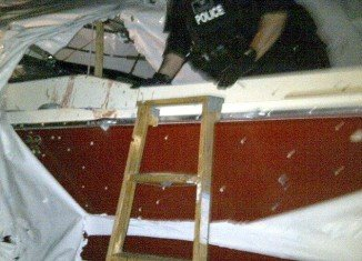 A newly released photo of David Henneberry's boat, where Boston bombing suspect Dzhokhar Tsarnaev was discovered, shows a bloodied, bullet-ridden port side