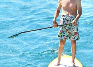 Bruce Jenner showed off his torso while going paddle boarding in the Aegean Sea