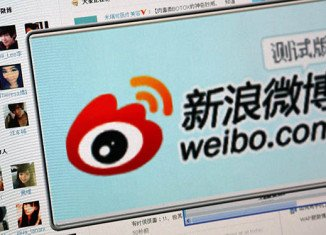 China's biggest e-commerce group Alibaba has bought an 18 percent stake in Weibo, China's largest Twitter-like service