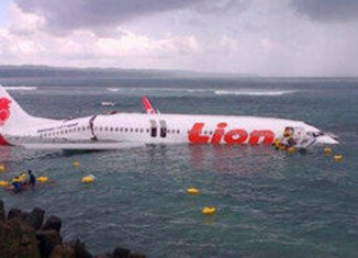 Everyone aboard a Lion Air passenger jet has survived after the plane has overshot a runway and ended up in the sea off Bali