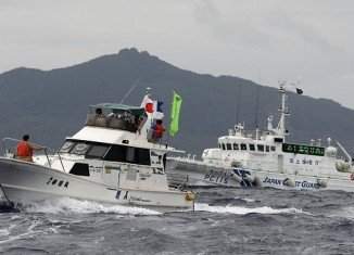 Japan's PM Shinzo Abe has warned China that his country will respond with force if any attempt is made to land on disputed island
