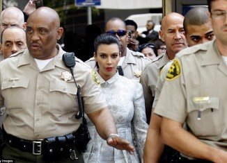 Kim Kardashian was escorted out of Los Angeles court house flanked by ten sheriffs