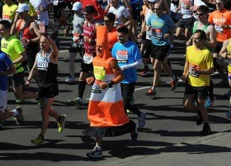 London Marathon runners wore black ribbons on their vests in honor of Boston Marathon bombings victims