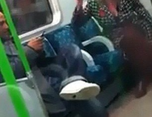 London police is haunting a woman who launched a tirade of foul-mouthed racist abuse towards another passenger on an eastbound District line train