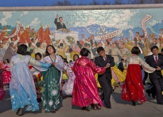North Korea celebrates Kim dynasty with song and dance as world watches for missile launch