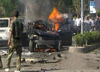 Syrian PM Wael al-Halqi has survived a car bomb attack targeting his convoy in western Mazzeh district of Damascus