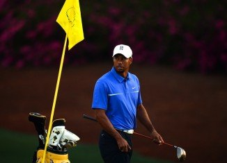 Tiger Woods has been given a two-stroke penalty at the Masters in Augusta, avoiding the threat of disqualification