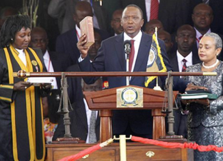 Uhuru Kenyatta has been sworn in as Kenya's president after winning elections against Raila Odinga back in March
