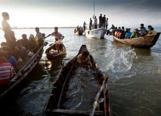 A boat carrying about 200 Rohingya Muslims has capsized off western Burma