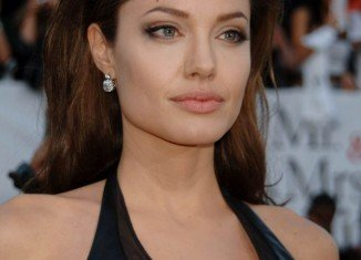 Angelina Jolie has preventative double mastectomy as she had an 87 percent chance of contracting breast cancer