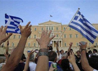 IMF report revealed Greece has made progress in improving its finances, but the country must do more to fight tax evasion