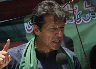 Imran Khan has been injured after falling off a makeshift lift that was taking him onto a stage at an election rally in Lahore