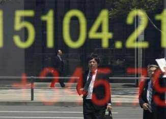 Japan's shares have climbed past the 15,000 mark for the first time since January 2008, as the yen continues to weaken