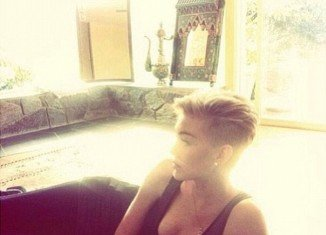 Miley Cyrus posts self portraits to Instagram and Twitter on daily basis