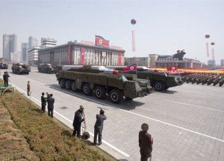 North Korea has removed two medium-range missiles from a coastal launch site, indicating a lowering of tension on the peninsula
