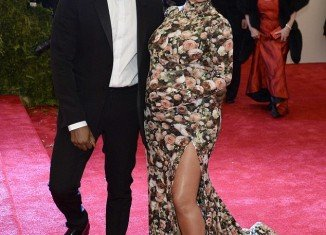 Pregnant Kim Kardashian misfired at the Met Ball in slit-to the-thigh Givenchy gown with matching shoes as she couldn't fit in her first choice dress