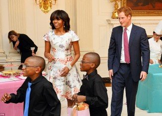 Prince Harry joined First Lady Michelle Obama at the White House at the start of his week-long U.S. tour