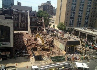 Apartment building collapses on top of Philadelphia thrift store killing six people