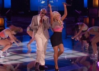 Christina Aguilera showed off her thin frame during her spirited performance of Feel This Moment with rapper Pitbull on The Voice Season 4 finale