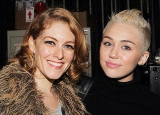 Dylis Croman has been identified as the mystery woman posing with Miley Cyrus in a cryptic Twitter post in which the singer gives her father Billy Ray a very public ultimatum