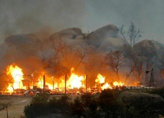 At least 19 firefighters died while fighting the blaze threatening the town of Yarnell, about 80 miles north-west of Phoenix