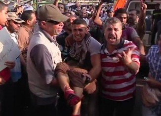 At least 34 Egyptians have been killed in a shooting incident in Cairo amid continuing unrest over the removal of President Mohamed Morsi