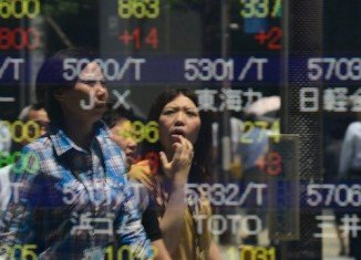 Japanese markets show a little change after PM Shinzo Abe was given a vote of confidence for his economic policy