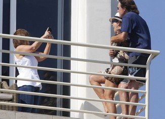 Kris and Bruce Jenner were spotted laughing and hugging on the balcony of Bruce's temporary seaside home in Malibu with their daughters Kendall and Kylie