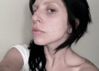 Lady Gaga looks unrecognizable in a make-up free snap she posted to a fan website