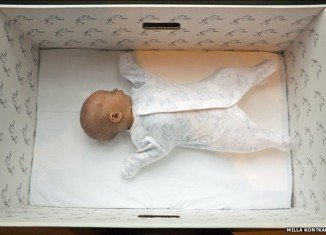 Many Finnish children, from all social backgrounds, have their first naps within the safety of the baby box's four cardboard walls
