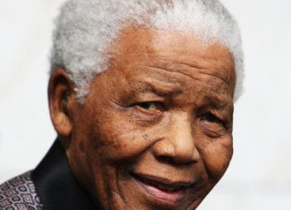 Nelson Mandela is responding to treatment but remains in a critical condition