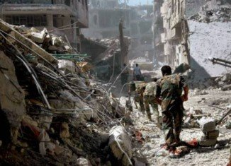 Syrian army has fully captured Khalidiya district that was a key rebel stronghold in the central city of Homs,