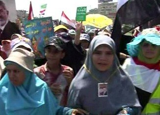 Tens of thousands of protesters are on the streets of Egyptian cities in rival shows of force by supporters and opponents of Mohamed Morsi