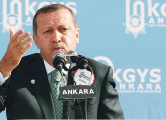 Turkey's PM Recep Tayyip Erdogan has threatened legal action against British newspaper Times for publishing an open letter criticizing his handling of recent protests