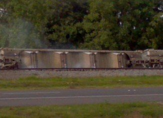About 100 homes have been evacuated in Louisiana after a derailed train carriage leaked toxic chemicals