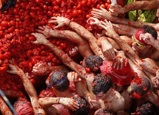 Each year thousands of tourists pack Bunol to take part in the hour-long tomato fight that leaves the streets running in red juice