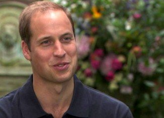 In his first interview since the birth of Prince George, the Duke of Cambridge said he and Kate Middleton were enjoying their new role as parents
