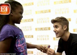 Justin Bieber broke the Make-A-Wish Foundation record by granting its 200th wish after spending time with sick 8-year-old fan Annalysha Brown-Rafanan and accepting her marriage proposal
